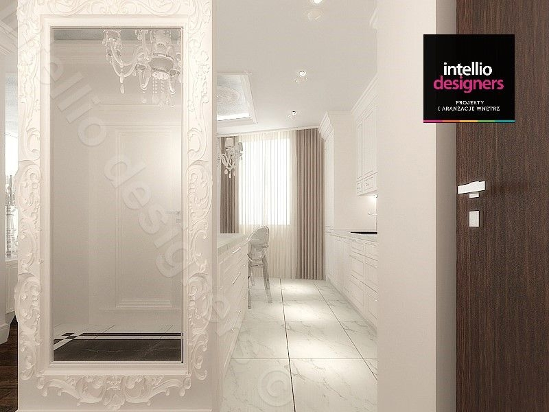 Przedpokój z lustrem w przepięknej oprawie. Niebanalny styl wnętrz komfortowego domu.