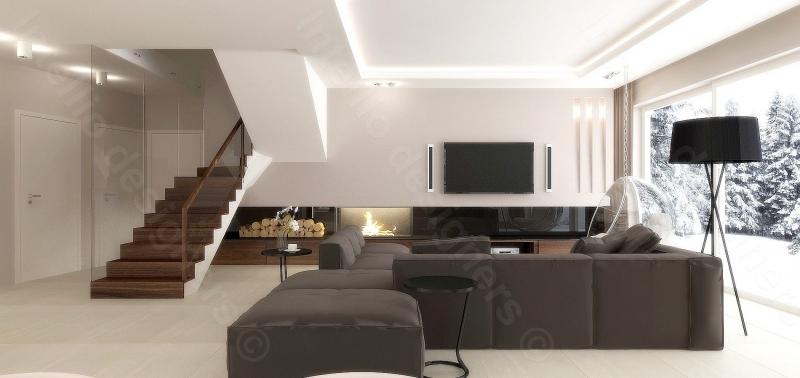 Aranżacja domu pod Krakowem salon komfortowymi meblami TV oraz kominek